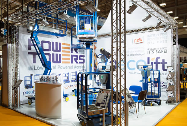 Power Towers using lighting gantry to build their exhibition stand
