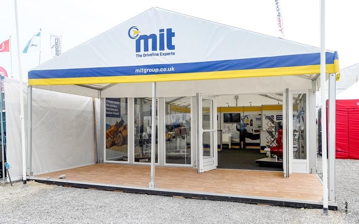 Outside exhibition marquee with modular display system and graphics creating the interior display for MIT Group at Hillhead exhibition.