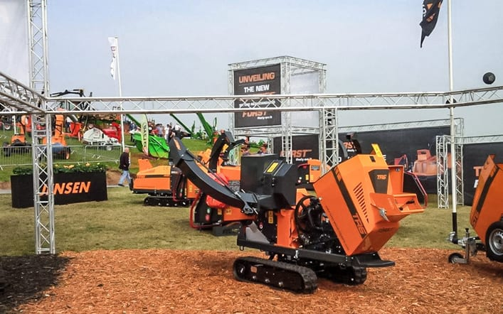 Large outdoor exhibition display using aluminium gantry and printed banners for Forst wood chipping machines at APF.