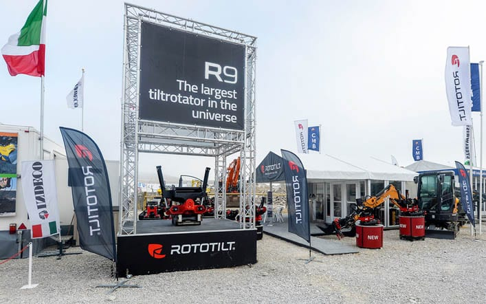 An aluminium truss system tower with integrated load bearing stage and outdoor banners for Rototilt at the Hillhead exhibition.
