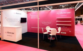 A shell scheme stand clad with traditional exhibition wall panels covered with printed PVC graphics.